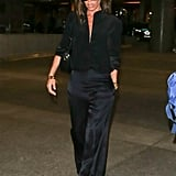 Victoria Beckham Wearing Silk Pants at the Airport