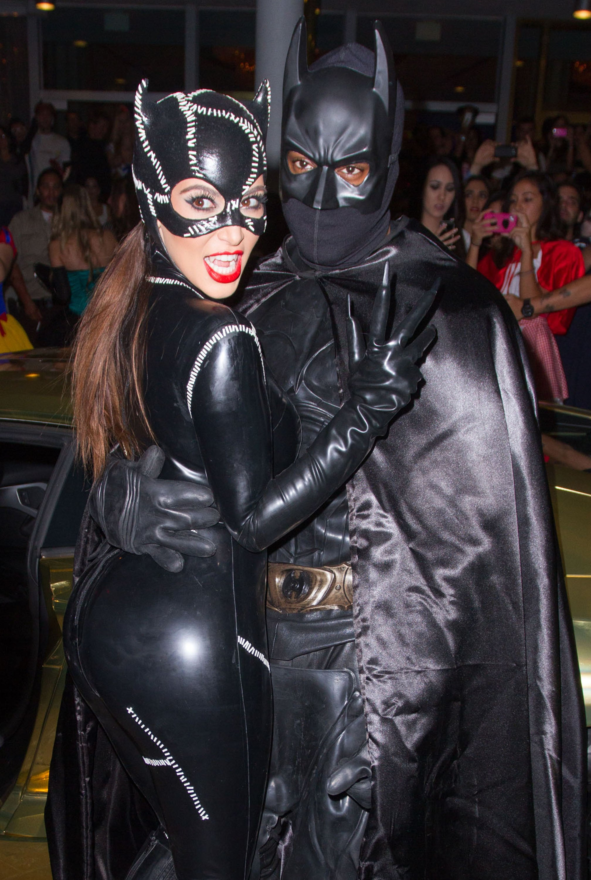 The pair dressed up as Batman and Catwoman for Halloween 2012 in Miami.