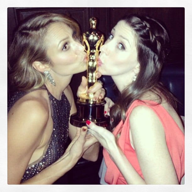 Stacy Keibler and a friend kissed George Clooney's Oscar