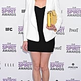 Kirsten Dunst's pretty yellow clutch popped against her black Dolce & Gabbana mini at the Independent Spirit Awards.