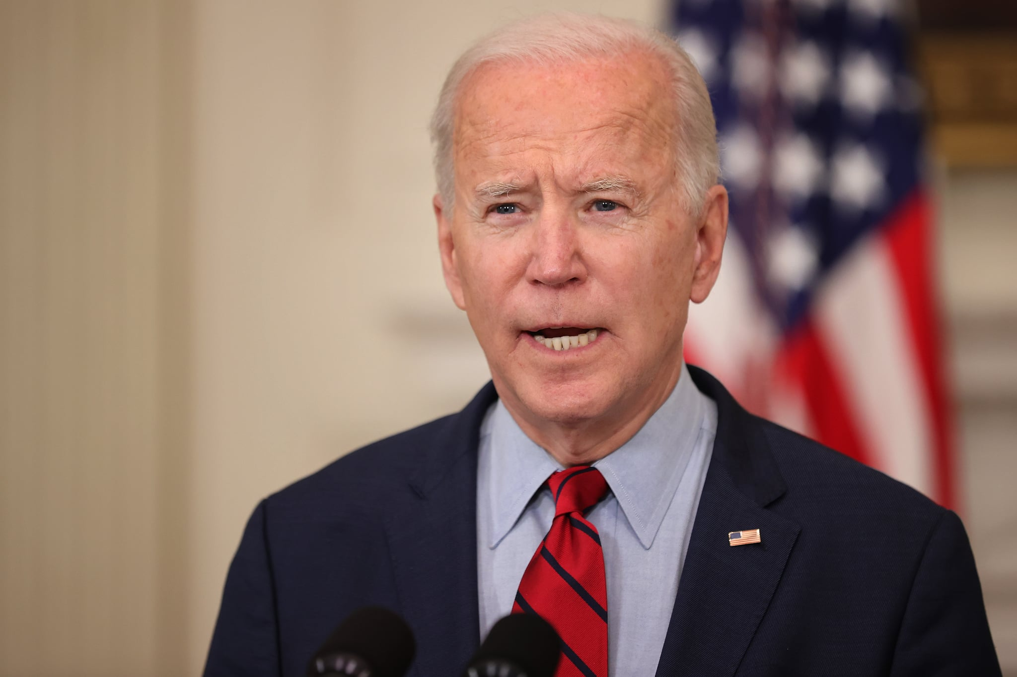 WASHINGTON, DC - MARCH 23: U.S. President Joe Biden delivers remarks about Monday's mass shooting in Boulder, Colorado, in the State Dining Room at the White House on March 23, 2021 in Washington, DC. Ten people were shot and killed at the King Soopers grocery store in Boulder and police have charged Ahmad Al Aliwi Alissa of Arvada, a suburb of Denver, with first-degree murder. This massacre comes less than a week after another mass shooting killed eight people — six of them women of Asian descent — at three spas in the Atlanta area.  (Photo by Chip Somodevilla/Getty Images)