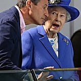 The queen wore blue on day one.