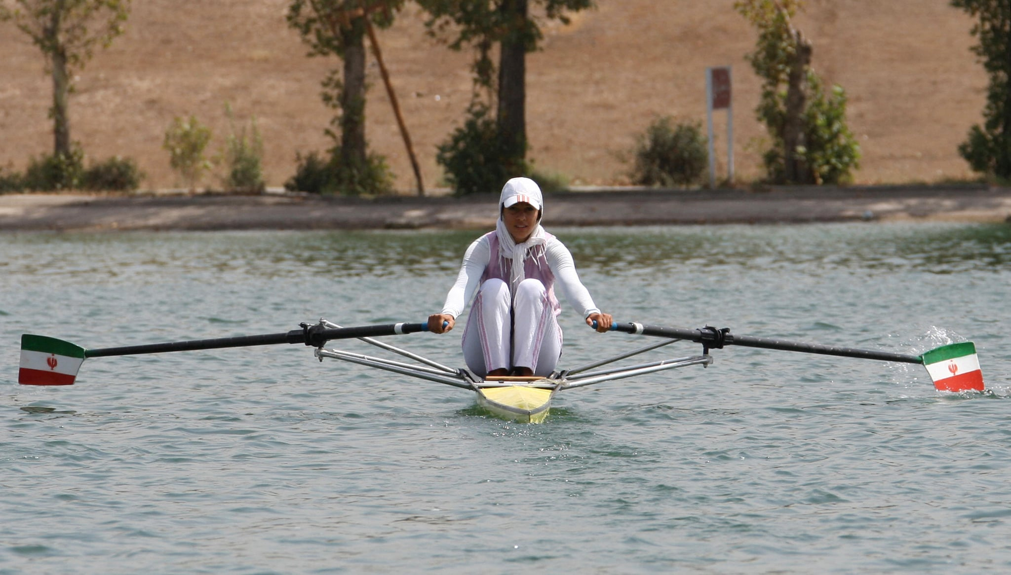 Homa trains at Azadi Stadium's artificial lake in Tehran.