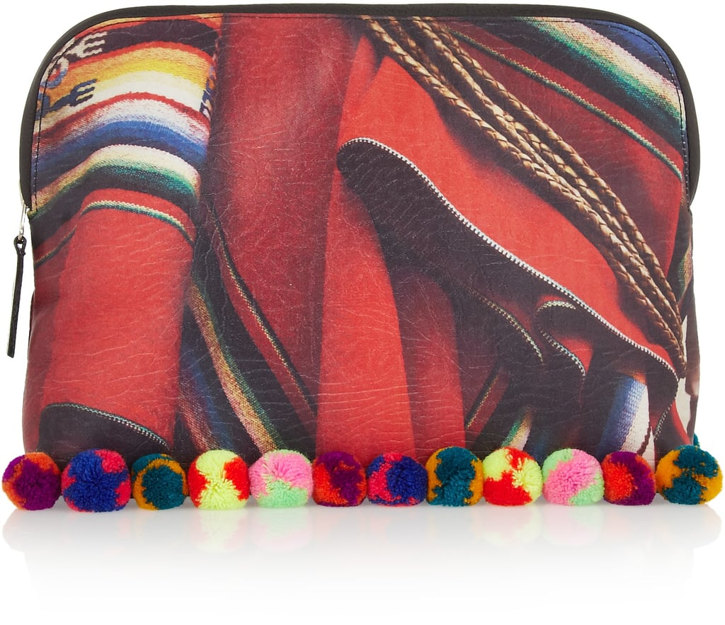 The colors of Mario Testino's vivid photography will come to life on June 5 when he debuts a small capsule collection created with Mate on Net-a-Porter. Some of the photos in Testino's latest exhibit, Alta Moda, which were shot in his native Peru, were enlarged and turned into prints. This bold handbag ($150), accented with pom-poms, is probably the most spirited piece in the collection. — Justin Fenner