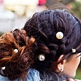 Lastly, if you're off to a winter wedding or want to look super-sweet for a date, pop some pearls into your 'do for an angelic look. Either go minimal in normcore style culottes and a roll neck jumper sporting just one pearl, or help hold up your braids with a whole set and wear a long length lace dress. One accessory, two completely different looks.