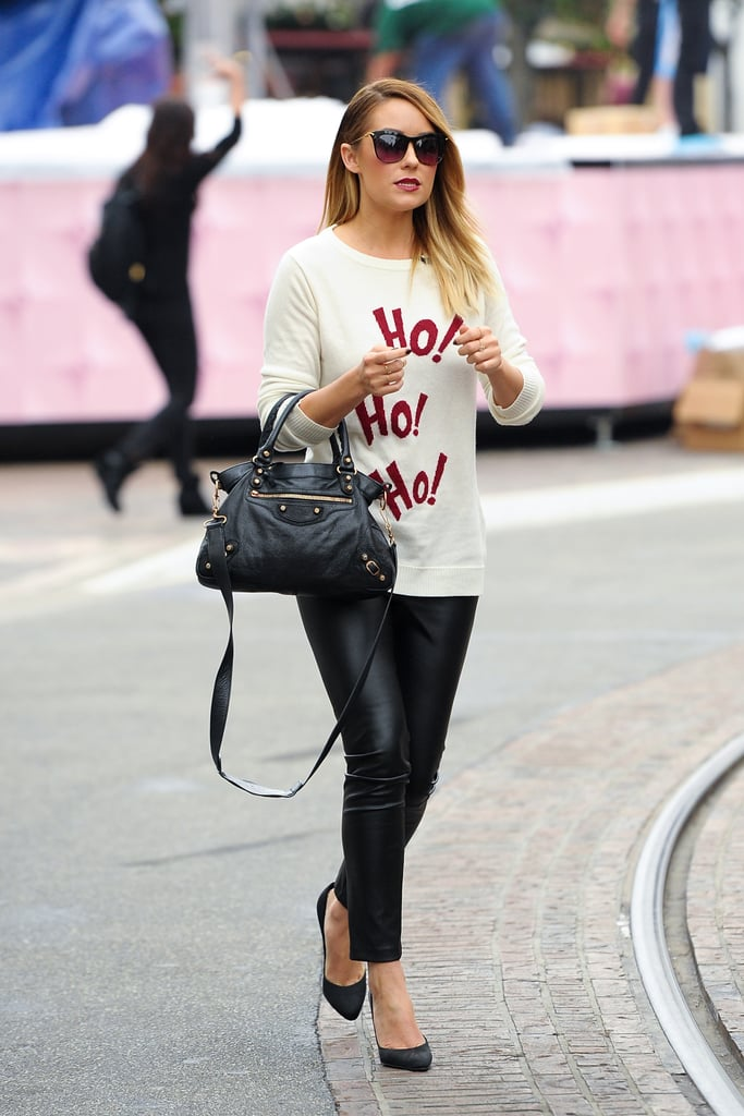 We love Lauren's fun take on holiday dressing — she wore this Lot78 sweater with leather leggings and pumps in 2012. Lesson from Lauren: aim to be fashionable and festive.