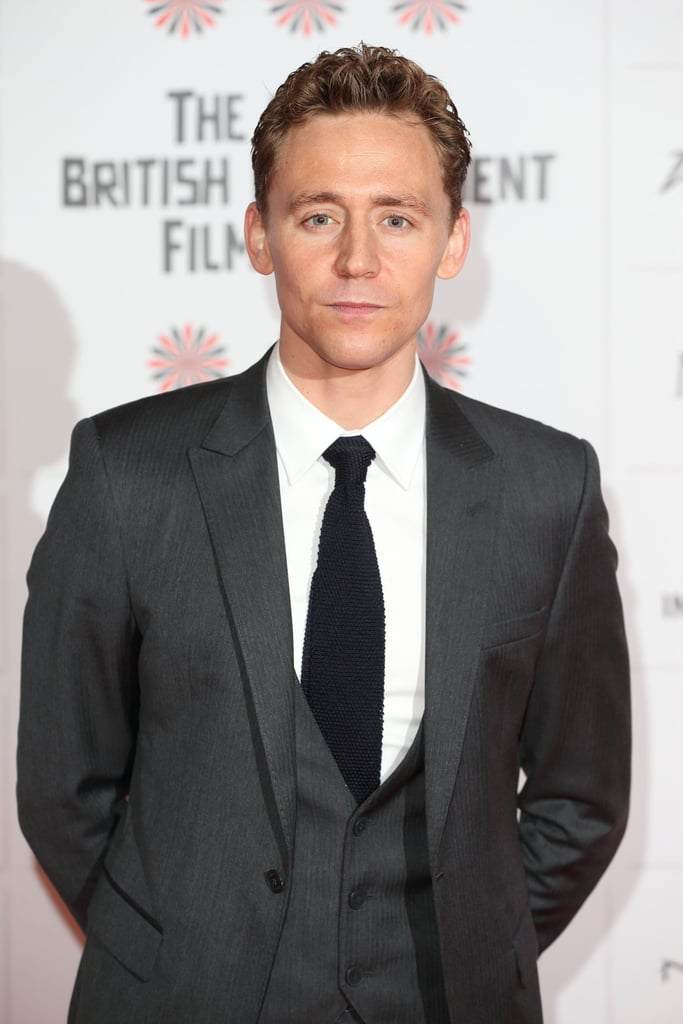 Tom Hiddleston posed in a three-piece suit at the BIFAs.