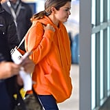 Selena Gomez's Louis Vuitton Bag and Sneakers at the Airport