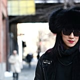 An all-black ensemble got a shot of color with vibrant raspberry-colored lipstick.