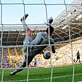 Hope Solo saves a ball during the quarterfinal match against Brazil.