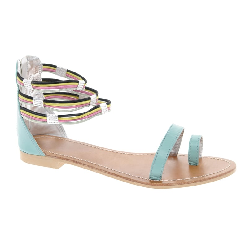 For a sandal on the funkier, bolder side, go with this multicolored sandal featuring elastic heel straps and toe and foot straps.  Asos Fizz Leather Flat Sandals With Multi Ankle Straps ($57)