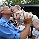 Jon Huntsman kisses a little baby during a Labor Day picnic in New Hampshire.