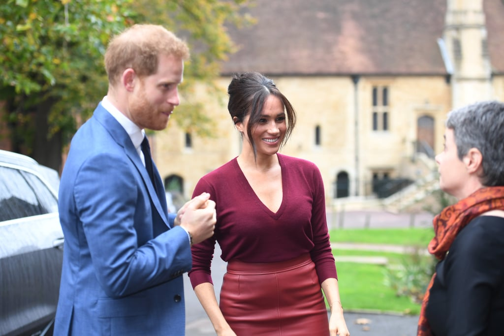 Meghan Markle put a new spin on one of her most memorable outfits on Friday, when she slipped into a chic leather pencil skirt and a matching top to attend a roundtable discussion on gender equality at Windsor Castle. The cranberry-colored ensemble, which she finished with coordinating suede shoes, instantly made us think of a similar look she sported just over a year ago, when she teamed a green leather pencil skirt with a matching blouse for a visit to West Sussex. It turns out this is the exact same Boss skirt in a new color, proving Meghan definitely knows what works for her. The duchess has a knack for choosing just the right monochrome separates for a sleek, modern look, and now she's proven she can do it in just about any autumnal color. But she's not the only royal who's recognized the impact this skirt makes. In fact, Queen Letizia of Spain wore it just yesterday, teaming her version with a white blouse with lace inserts on the sleeves. Meghan, meanwhile, opted for a delicate knit sweater with a v-neck to top her skirt. Finishing the look with minimal jewelry and a soft updo, she looked relaxed and elegant as she and Prince Harry made their way inside the venue. Keep reading to take a closer look at the outfit and to see the other times this garment got the royal seal of approval.      Related:                                                                                                           Meghan Markle Saves This Aritzia Dress For Special Occasions, and We Can See Why