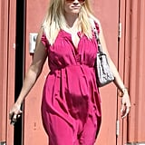 """Though Reese Witherspoon still hadn't """"officially"""" announced her pregnancy, the star's bright pink Easter dress left little to the imagination."""