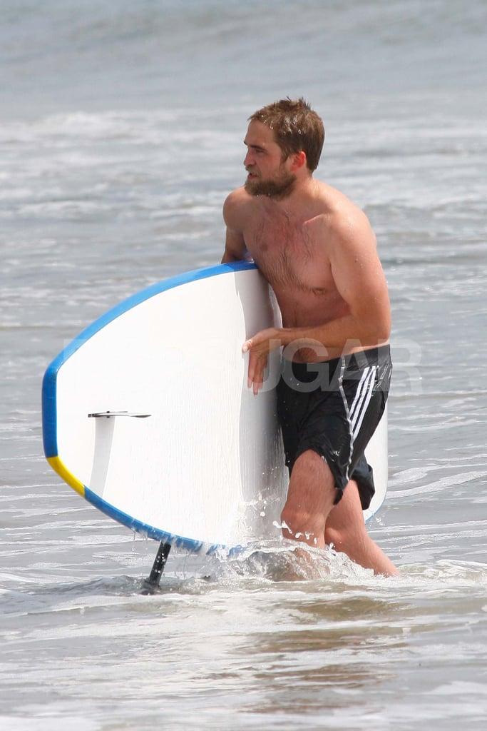 Robert Pattinson held onto his paddleboard.