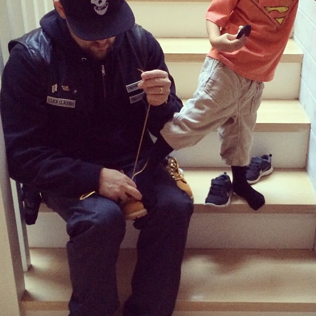 Joel Madden took a break to help Sparrow with his shoes. Source: Instagram user joelmadden
