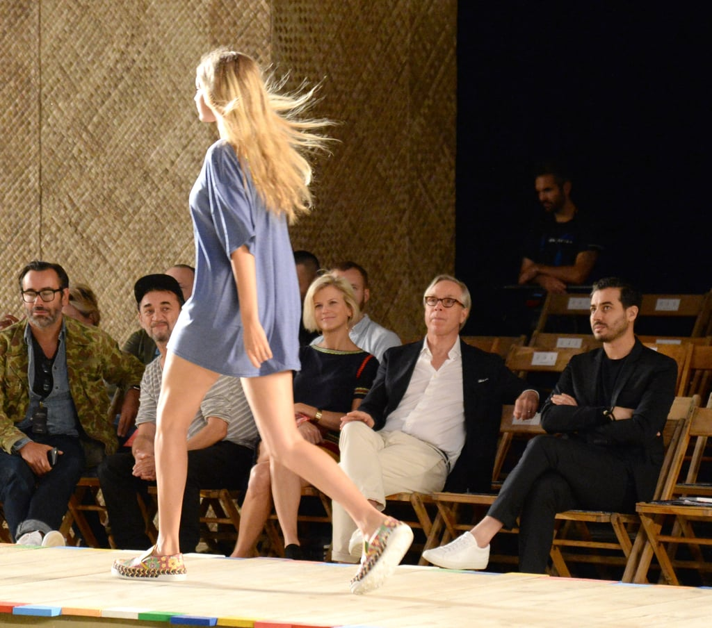 Gigi practiced her walk at the Tommy Hilfiger show in a loose blue tee.