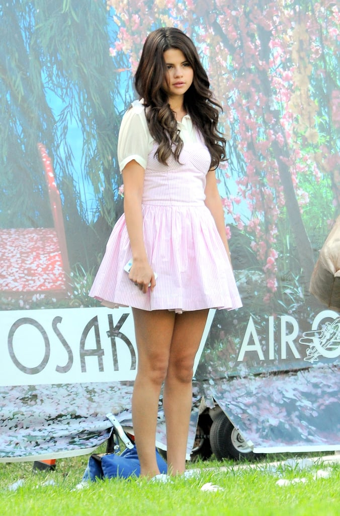 Selena Gomez sported a striped, light pink dress.
