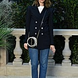 Sofia Coppola dressed casually in a blazer and crossbody bag.