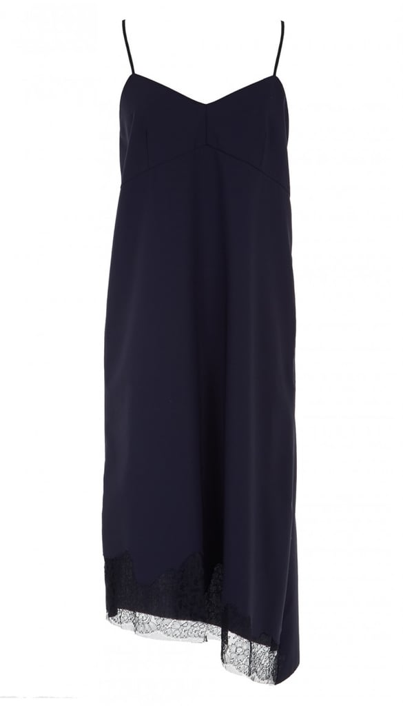 """""""You'll be wearing this Tibi Slip Dress ($425) so many different ways — with sweatshirts and sweaters layered under and over; with tights and booties; or bare legs and heels to dress it up — it will surely become the hardest-working dress in your closet."""" — HWM"""
