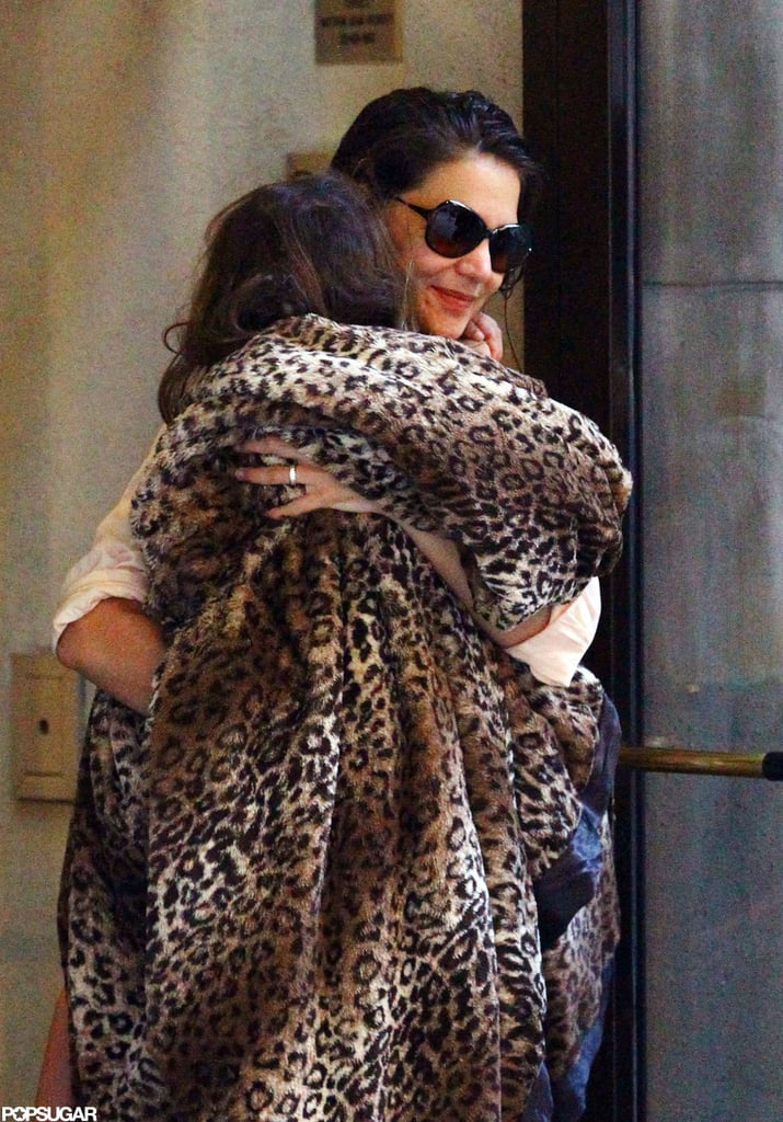 Katie Holmes carried Suri Cruise as they left their NYC apartment.