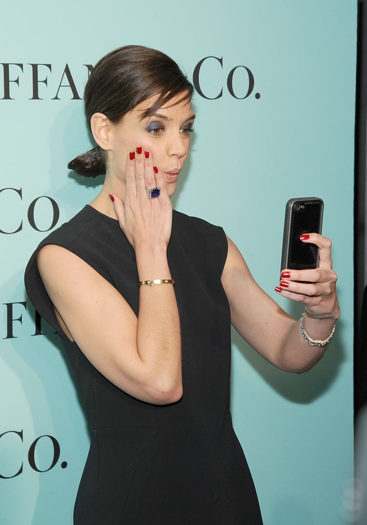 Katie Holmes took a selfie on the red carpet at Tiffany's Blue Book Gala at the Guggenheim Museum in NYC on Thursday.