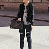 A leather-sleeved bomber added downtown-girl appeal to a pair of distressed denim and a basic tee. Source: Lookbook.nu