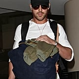 Ryan Gosling wore a backpack at the airport.