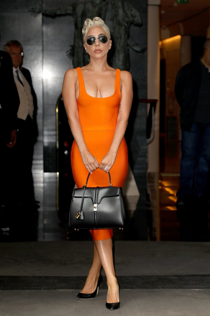 Wearing a House of CB body-con dress with a Céline handbag and Jimmy Choo heels.