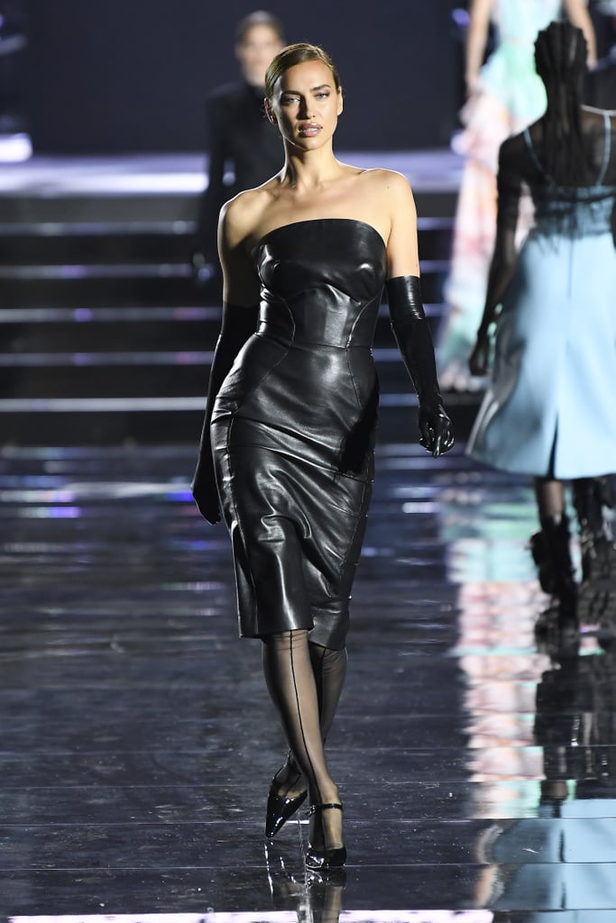 Irina Shayk is back to work after announcing her split from Bradley Cooper after four years. On June 13, the model exuded strength and confidence as she delivered a powerful walk at the CR Runway Luisaviaroma 90th Anniversary Show in Florence.  Irina did have a little help from her badass styling, which included a leather Ermanno Scervino dress with matching latex gloves, as well as one of the sexiest pinstripe skirt suits we've ever seen, from the Mugler archives. Irina was also in good company as she walked alongside Bella Hadid and Joan Smalls at one point. Other models in attendance included Alessandra Ambrosio, Karolina Kurkova, Halima Aden, Lara Stone, and Gigi Hadid.  The star-studded show was hosted by fashion editor and CR Fashion Book founder Carine Roitfeld, and it served as the debut of her CR Runway events venture. The show also commemorated the 90th anniversary of the famed Florentine luxury retailer Luisaviaroma. Look ahead to see some seriously stunning photos of Irina walking in the show.      Related:                                                                                                           Over 50 Photos of Irina Shayk Being Insanely Sexy