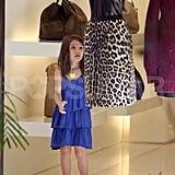 Suri Cruise checked out a high-end skirt.