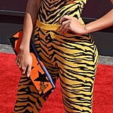 Charli XCX's rectangle star clutch was a wild contrast to her electric zebra-print outfit.
