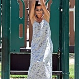 Halle Berry swung from the park equipment.