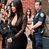 Even this cop couldn't help but check out Kim Kardashian as she exited her hotel in NYC in Aug. 2014!