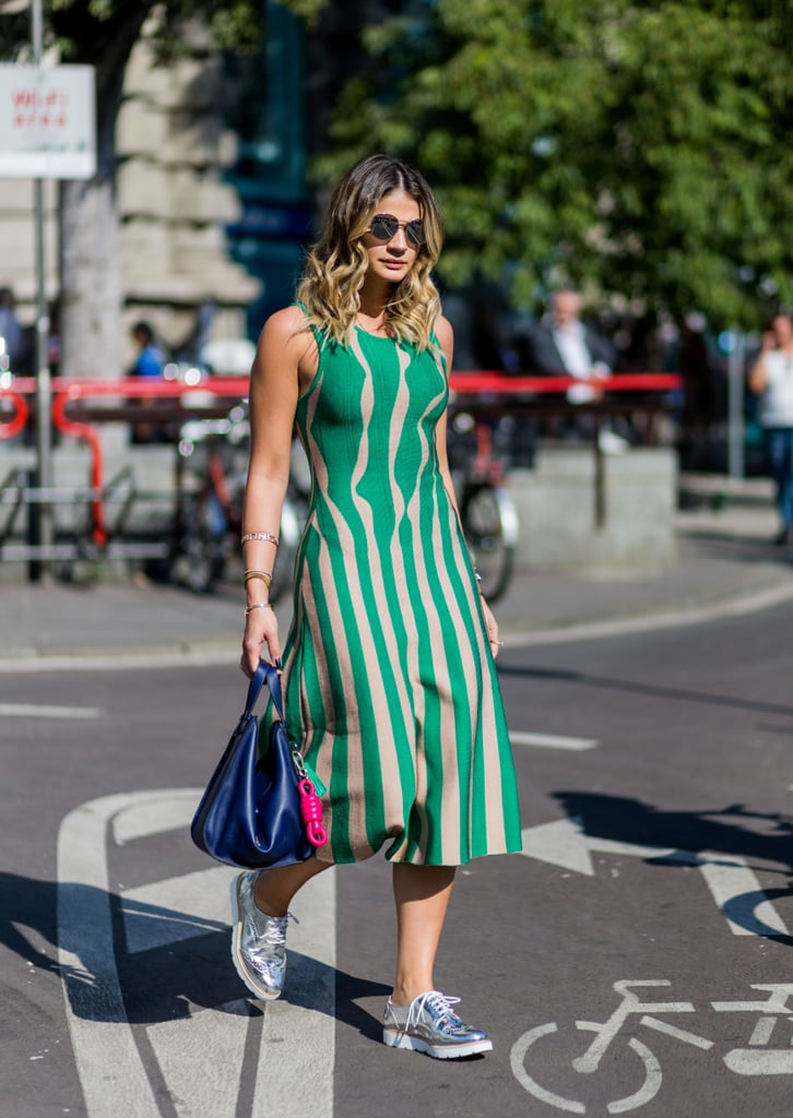 There's nothing cooler than a printed dress, sneakers, and shades.