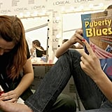 While getting her toes done, a model read Puberty Blues by Kathy Lette and Gabrielle Carey before walking the runway during  L'Oreal Melbourne Fashion Festival in 2006.