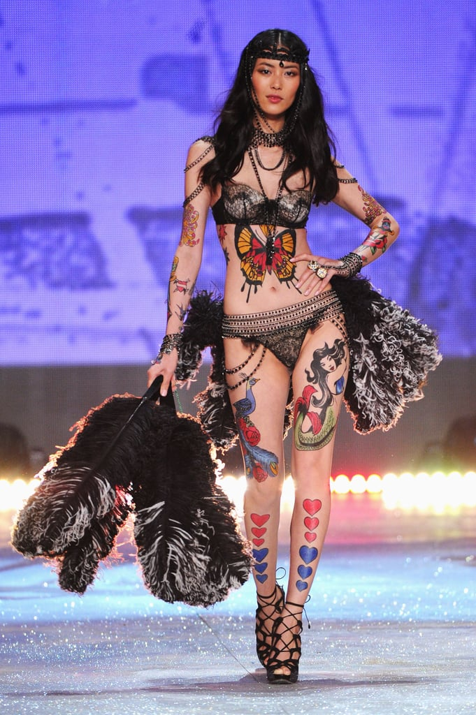 Liu Wen wore feathers on the runway at the Victoria's Secret Fashion Show in NYC.