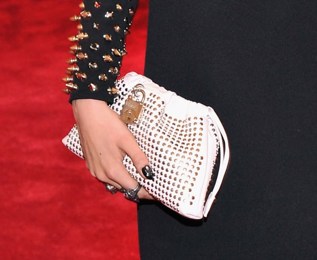 Cara Delevingne carried a white Burberry clutch.