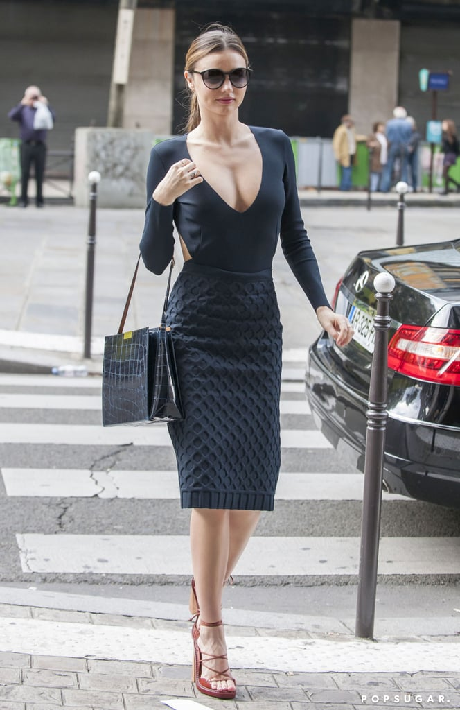 Miranda Kerr displayed her sexier side in a cleavage-revealing black top during a Parisian outing.