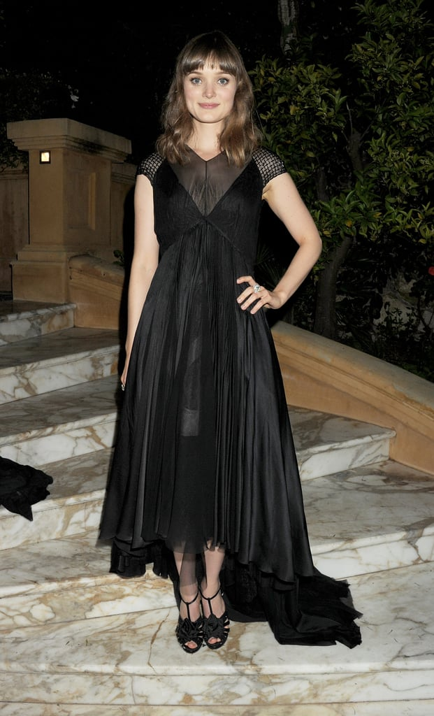 Bella Heathcote donned yet another dark ensemble, this time an empire-waist dress with an asymmetrical hem, at the Killing Them Softly afterparty.