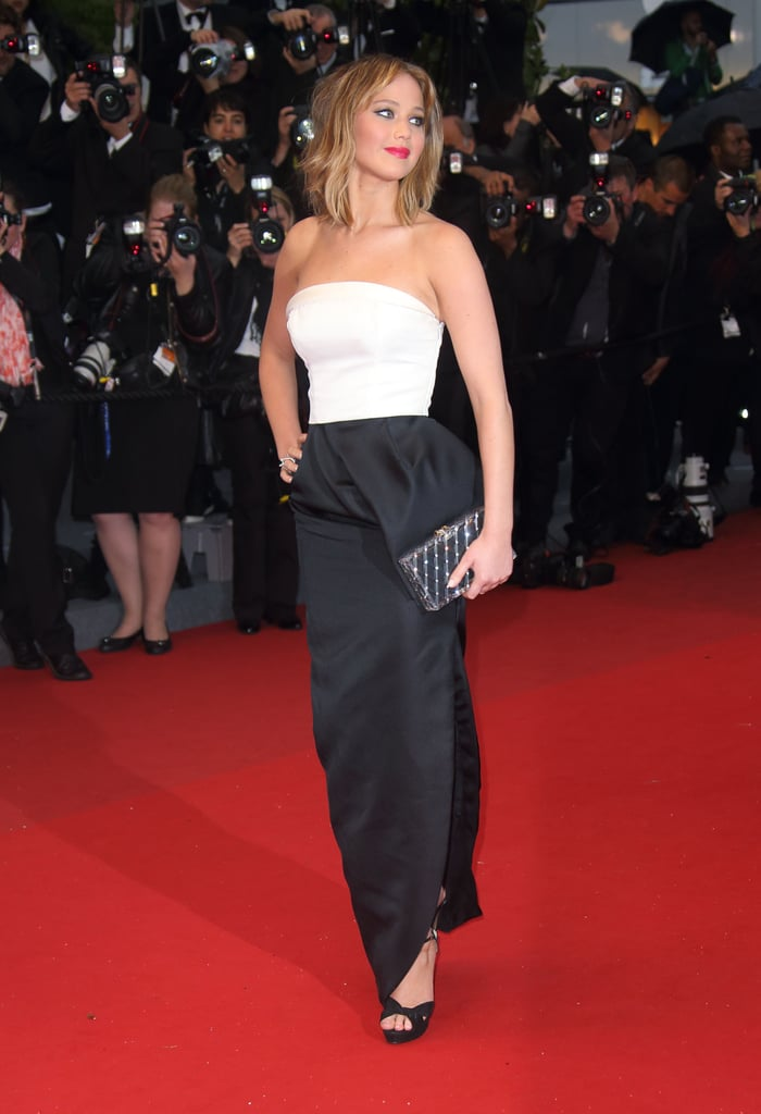 What better way to step out at the Cannes Film Festival than in a sleek black-and-white outfit by Christian Dior — accessorised with a sparkling box clutch, of course.