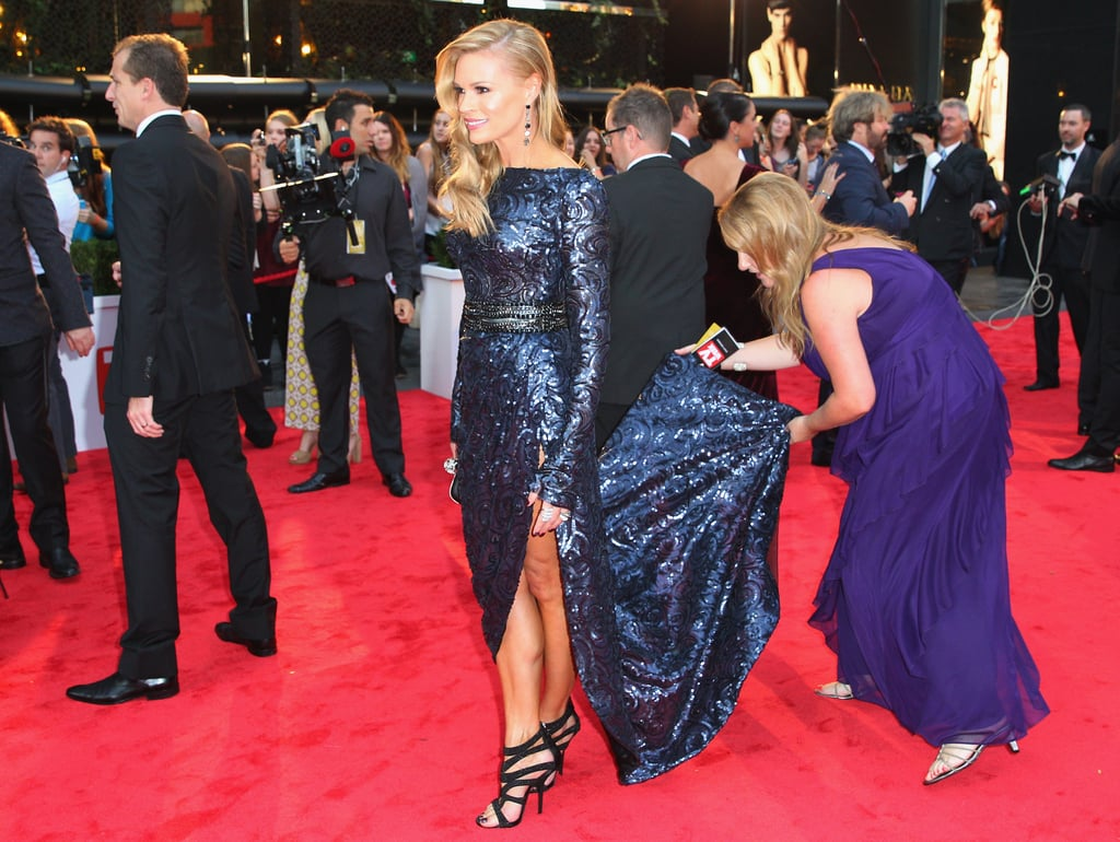 Sona Kruger had her sparkling Steven Khalil dress attended to on the Logies red carpet.