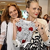 An expectant Molly Sims swooned for the DVF patterned onesie.