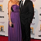 Stacy Keibler and George Clooney hit the red carpet at the 15th annual Hollywood Film Awards gala.