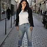 The easiest outfit formula is a white t-shirt and jeans, as evidenced by plus-size model Clementine Desseaux. No matter what size or shape you are, you can pull it off. To make the look your own, style it with booties or sneakers and add a colorful Springtime accessory.