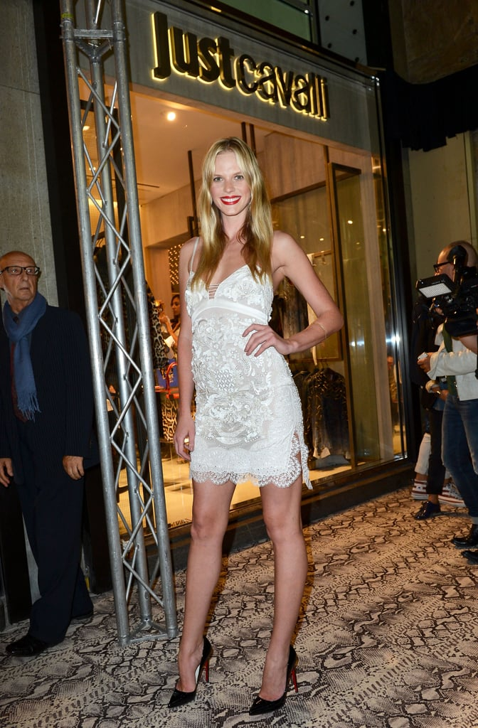 Anne Vyalitsyna goes for a leggy look in a lacy LWD and slick black pumps at the Just Cavalli opening.