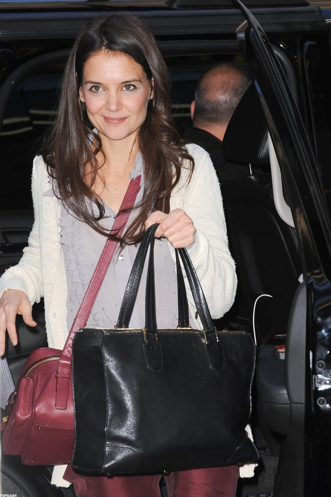 Katie Holmes had her hands full as she arrived.