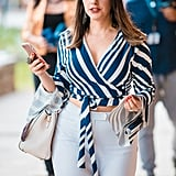 Show Off a Touch of Skin in a Wrap Blouse and White Pants
