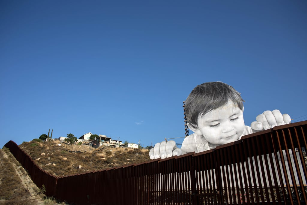 Moving Wall Art mexico border wall art installation of a childjr | popsugar news