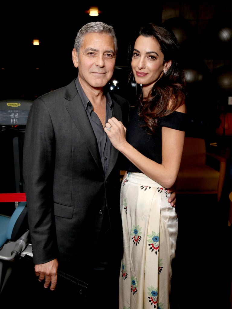 Amal's printed Ossie Clark pants feature a Celia Birtwell print from the '70s.